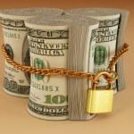 Dollar on lock — Stock Photo