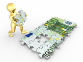 Men with euro from parts of puzzle — Stock Photo