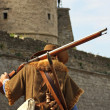Musketeer against the backdrop of the castle — Stock Photo
