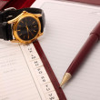 Memoranda with clock and pen. - 图库照片