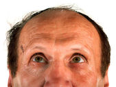 Balding mail looking up — Stock Photo