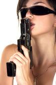Sexual girl with gun — Stock Photo