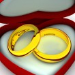 Box as heart with wedding rings — Stock Photo