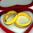 Stock Photo: Box as heart with wedding rings