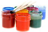 Paints and small brushes — Stock Photo