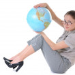 Woman with a globe — Stock Photo #3415635