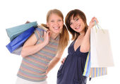 Two young women with purchases — Stock Photo