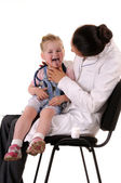 Child and doctor:throat checking — Stock Photo