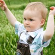 Baby playing in green summer grass — Stock Photo