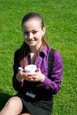 Student drinking tea at the park — Stock Photo