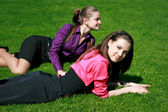 Young businesswomen relaxing on the grass — Stock Photo