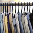 Mix color Shirt and Tie on Hangers - Stock Photo