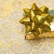 Gold gift box with bow - Stok fotoğraf