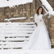 Bride in winter near the stair — Stock Photo