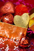 Gift box with red hearts — Stock Photo