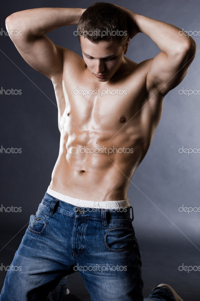 Young bodybuilder man on black background — Stock Photo #2797109