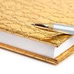 Golden notebook — Stock Photo