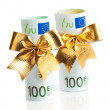 Copulla of euro with golden bow — Stock Photo