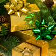 Gold gift boxes with Christmas tree - Stockfoto