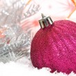 Pink Christmas balls on snow background - Stockfoto