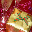 Golden gift box with glass — Stock Photo