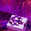 Gift box with violet feather - Stock Photo