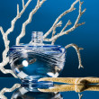 Blue bottle of perfume - Stock Photo
