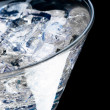 Glass with martini and ice - Stock Photo