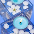 Candle with spring flowers - Stock Photo