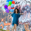 Happy woman with balloons - Stock Photo