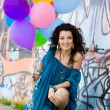 Stock Photo: Happy woman with balloons