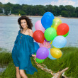 Happy woman with balloons — Stock Photo #2821339
