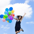 Happy woman with balloons — Stock Photo #2821389