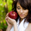 Wonderful girl with red apple - Stock Photo