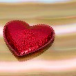 Red heart on gold background — Stock Photo