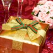 Gift box with glasses of champagne — Stock Photo