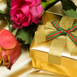Gift box with red and yellow roses — Stock Photo