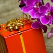 Gift box with purple orchid — Stock Photo #2827347