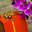 Royalty-Free Stock Photo: Gift box with purple orchid