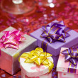Gift boxes with hearts and glass — Stock Photo