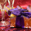 Stock Photo: Gift box with hearts and glass