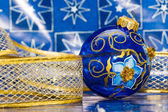Blue festive decoration with ribbon — Zdjęcie stockowe