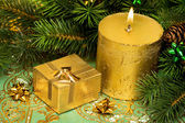 Gold festive candle and present with tree — Stok fotoğraf