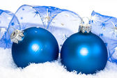 Blue Christmas balls on snow background — ストック写真