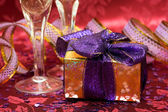 Gift box with hearts and glass — Stock Photo