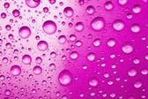 Paarse waterdruppels voor achtergrond — Stockfoto