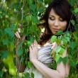 Beautiful girl in a birchwood — Stock Photo