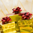 Golden gift boxes with ribbon - Stockfoto
