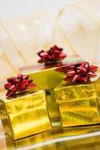 Golden gift boxes with ribbon — Stok fotoğraf