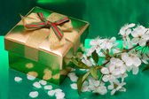 Gift box with white flowers — Stock Photo
